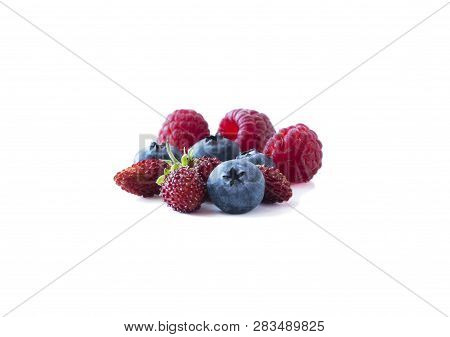 Berries Isolated On White Background. Ripe Blueberries, Raspberries And Wild Strawberries. Backgroun