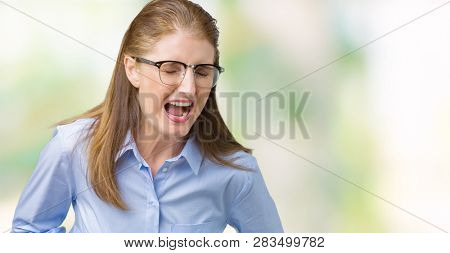 Beautiful middle age mature business woman wearing glasses over isolated background Smiling and laughing hard out loud because funny crazy joke. Happy expression.