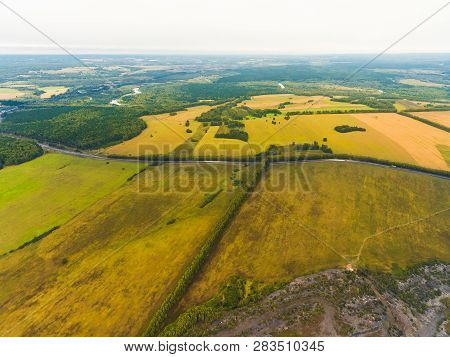 Panoramic Aerial View Of Fields, Road And River. Birds-eye View Of The Land With Fields, Meadows And
