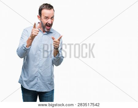 Middle age hoary senior business man over isolated background pointing fingers to camera with happy and funny face. Good energy and vibes.