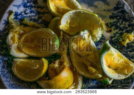 Rest Of Food, A Plate Full Of Orange Bagasse In A Dead Nature Style Photo