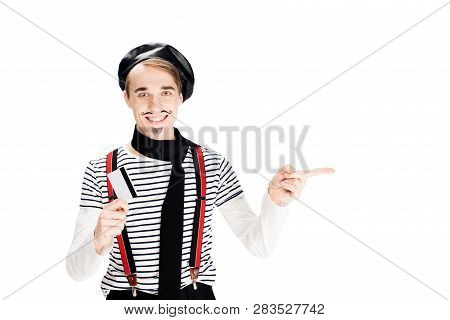 Cheerful French Man Holding Credit Card And Pointing With Finger Isolated On Shite
