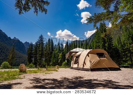 Camping on the shores of lake. Lake Dobbiaco in the Dolomites, Beautiful Nature Italy natural landscape Alps.