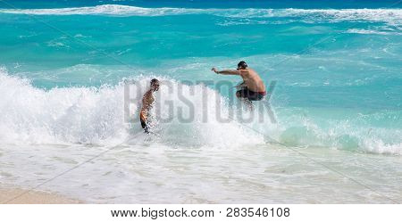 Mexico, Cancun - February 15, 2018: People Playing On Waves. Cancun Grand Pyramid Entertaining Compl