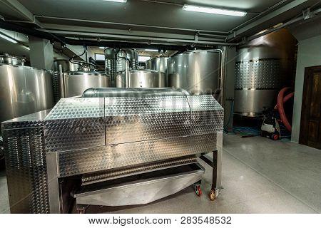 Inox Wine Barrels Stacked In Modern Winery Cellar In Spain.