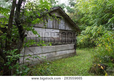 Behind The Wooden Shed. Old Weathered Rural Wood Shed In The American Midwest.