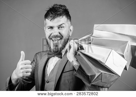 Man Bearded Elegant Businessman Carry Shopping Bags On Grey Background. Make Shopping More Joyful. E