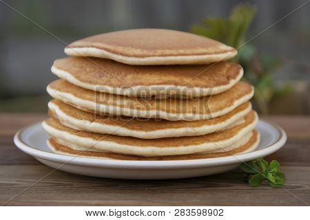 Pancakes. Stack Of Isolated American Pancakes Over Wooden Table. Breakfast,