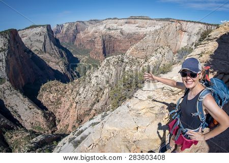 Fisheye Wide Angle View Of The Zion National Park Observation Point Trail In Utah, With A Woman Hike