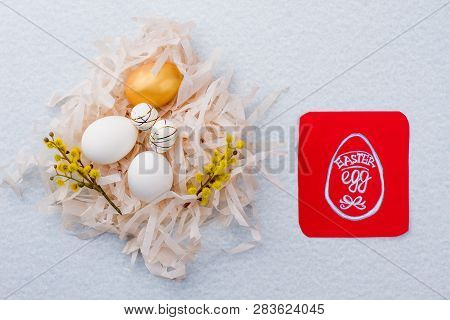 Five Easter eggs in paper nest. Nest with chicken and artificial eggs decorated with pussy-willow. Card with Easter egg. poster