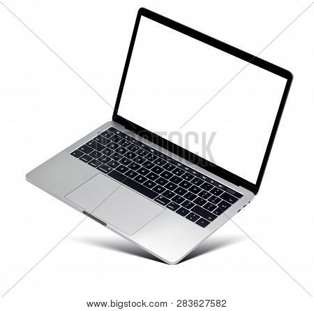 Hovering Aluminium Laptop With Blank Screen And New Design, Isolated On A White Background.