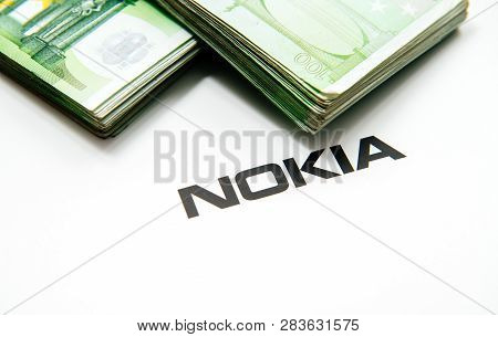 Paris, France - Nov 15, 2018: Stack Of Hundreds Of Euro Banknotes Currencies Near Nokia Logotype On