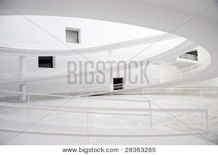 Modern white abstract building with windows and sloopes