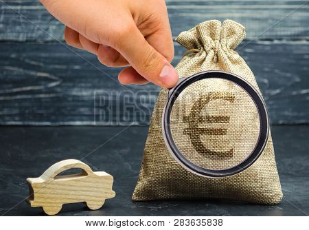 Money Bag With Euro Sign And Miniature Car. The Concept Of Saving Money To Buy A Car. Auto Insurance