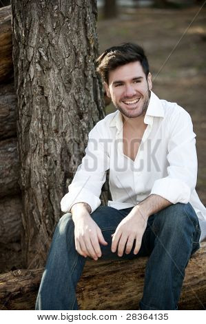 Portrait of a handsome young man in nature.