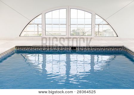 Luxury swimming pool with lot of windows.