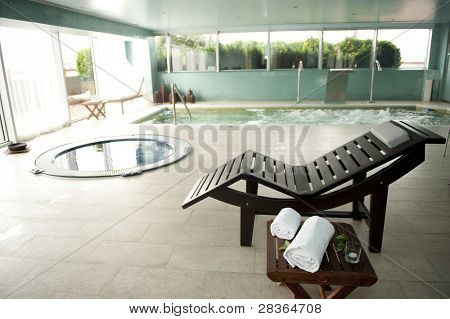 Empty luxury spa with jacuzzi and swimming pool
