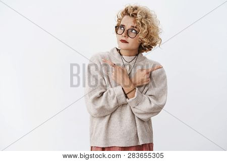 Unsure And Hesitant Cute Questioned Hipster Female Wearing Glasses And Makeup Raising Eyebrow Doubtf