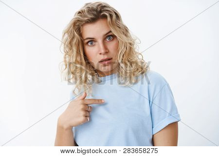 Who, Me. Portrait Of Questioned And Shocked Woman Point At Herself Holding Finger On Chest And Widen