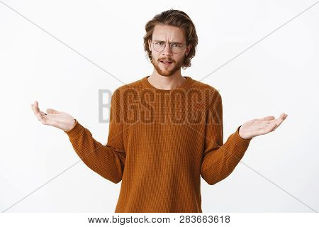Waist-up Shot Of Displeased And Disappointed Good-looking Young Male In Glasses And Brown Sweater Fr