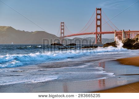 Golden Gate Bridge view from Baker Beach. Pacific coast landscape. San Francisco, California, USA