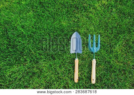 Garden Tools On Green Lawn Background. Seasonal Spring Or Summer Yard Work Concept, Growing And Seed