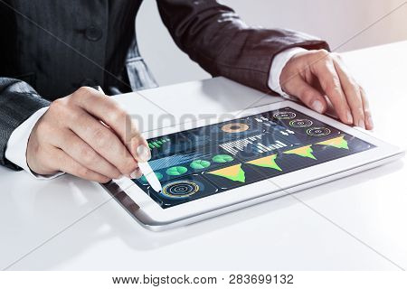 Close Of Businesswoman Sitting At Table And Touching With Stylus Tablet Pc
