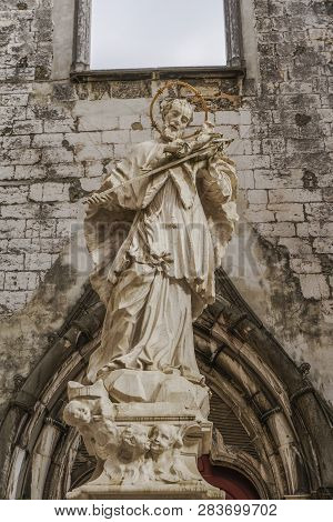 Lisbon, Portugal - July 19 2018: Carmo Chruch Convent Statue. Sculpture Of John Of Nepomuk In The Ma