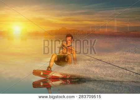 Summer Sports: Wakeboarder Speeding Fast Against The Sunset. Active Healthy Vacation