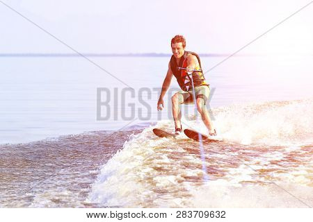 Waterskier With Glowing Spray At Sunny Day, Active Summer Water Sport, Copy Space