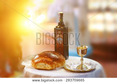 Holy Communion On Wooden Table In Church.taking Communion.cup Of Glass With Red Wine, Bread On Table