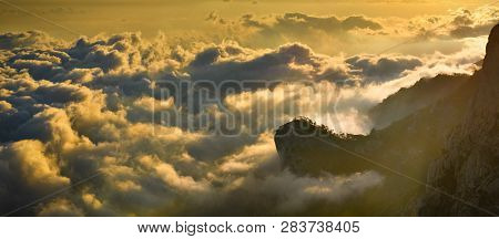 Misty Mountains. Sunlit Cloudscape In Misty Mountains.