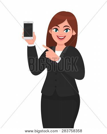 Cheerful Businesswoman Showing Blank Screen Mobile, Cell Or Smart Phone And Pointing Hand Finger Tow