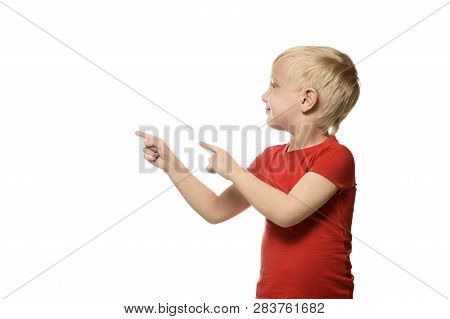 Smiling Little Blond Boy In A Red Shirt Stands And Shows Index Fingers To Side. Isolate On White Bac