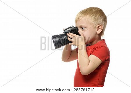 Young Blond Cute Boy With Digital Camera