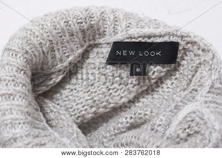 Kharkov, Ukraine - January 17, 2019: Tag With Words New Look On The Collar Of A Knitted Gray Sweater