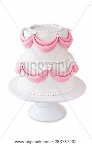 White Wedding Cake With Pink Elements Made From Pastry Mastic Isolated. Sugar Flowers, Marzipan Flow