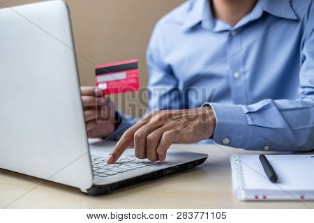 Businessman Holding Credit Card  For Online Shopping While Making Orders Via The Internet. Business,