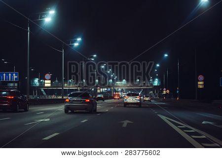 Urban City Traffic Cars In Night Illuminated Asphalt City Road, Abstract Cityscape Transportation Co