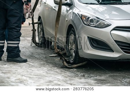 Evacuation of car by tow truck for violation of road rules or damaged and broken auto, close up poster