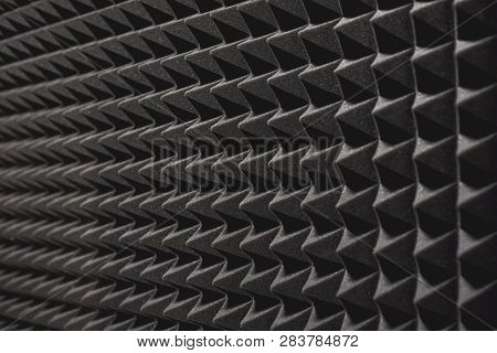 Nobody Will Hear You. Close Up View Of A Grey Soundproof Coverage On The Wall In Music Studio.