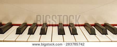 The Most Melodious Musical Instrument. Close Up View Of Black And White Piano Keys. Music Concept