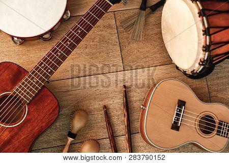 Ethnic Musical Instruments Set: Tambourine, Wooden Drum, Brushes, Wooden Sticks, Maracas And Guitars