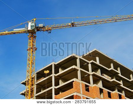Tower Crane On The Background Of Construction. Construction Site Background. Construction Crane Near