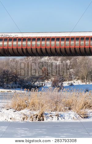 Subway Overground Tunnel Passing Over Frozen Pond, Sunny Winter Freezing Day, Prague Between Metro S