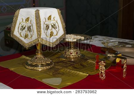 Holy Eucharist In Orthodox Church: Prepared For Sanctification Pieces Of Bread And Wine In Covered C