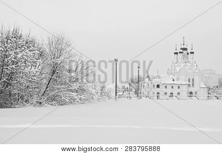 Church And Trees In Snow In Winter Black And White
