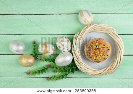 Happy Easter. Painted Eggs On Wooden Table. Easter Cake - Russian And Ukrainian Traditional Kulich,