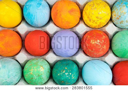 Happy Easter Card. Colorful Shiny Easter Eggs On Wooden Background. Copy Space For Text.