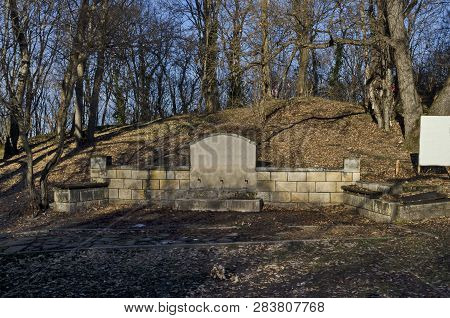 View of  fountain with three tap in field above Demir Baba Teke, cult monument honored by both Christians and Muslims in winter near Sveshtari village, Municipality Isperih, Razgrad District, Northeastern Bulgaria poster